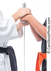 black belt in martial arts that holds the hilt of the sword...