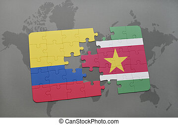 puzzle with the national flag of colombia and suriname on a...