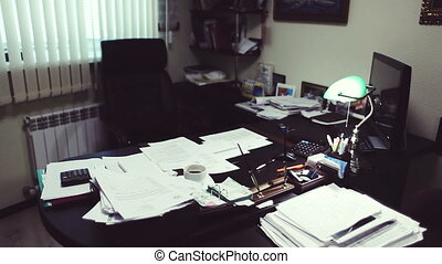Director at the desk, reviewing business documents,...