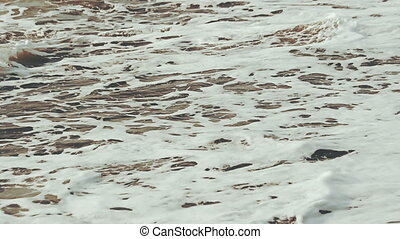 Close-up of sea waves at high tide Powerful streams of water...