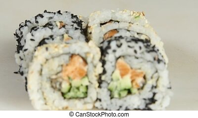 Rolls with various fillings and sesame seeds Close up -...