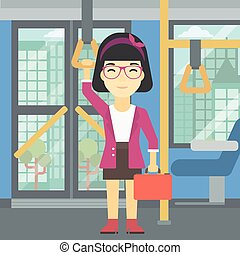 Woman traveling by public transport - An asian woman...