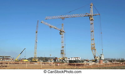 Four construction cranes working on the site - The...