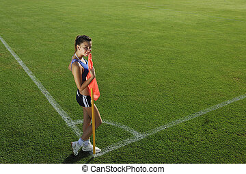 young woman on corner of soccer stadium - young woman on the...