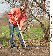woman working with shovel - young woman working with shovel...