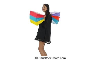 Woman holding shopping bags Shopping White Slow motion -...