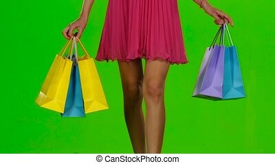 Shopping. Sale period. Green screen. Slow motion - Woman...
