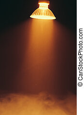 halogen lamp with reflector, warm spotlight in a fog