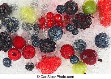 different juicy berries frozen in ice