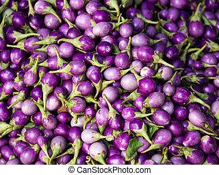 Round fresh organic raw purple brinjal or eggplant or...
