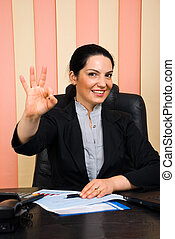 Happy business woman showing okay sign hand - Beautiful...
