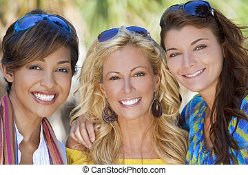 Three Beautiful Young Women Friends Laughing On Vacation -...