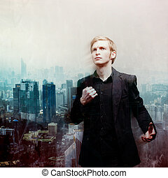 ambitious young man on background of megalopolis, double...