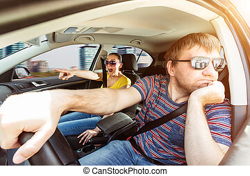 Couple driving in the car