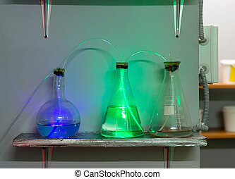 Flasks with chemical reagents - Three flasks with chemical...