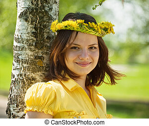 girl in dandelion wreath - Brunette teen girl in dandelion...