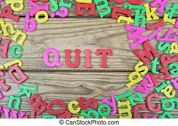 Quit on wooden table