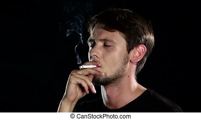 Bad habits. Man in depression with cigarette. Black. Close...