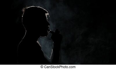 Bad habits. Electronic Cigarette. Black. Silhouette. Close...