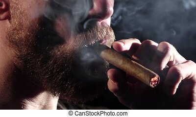 Detail of a person smoking cigar. Black. Close up. Slow motion