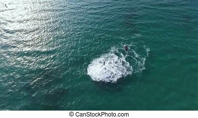 Man flying over sea on flyboard Aerial view from copter Full...