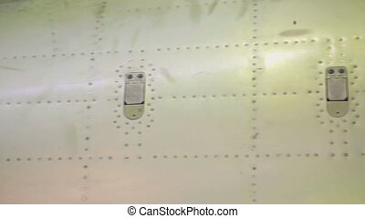 Fuselage of aircraft with riveted seams and coated with a...
