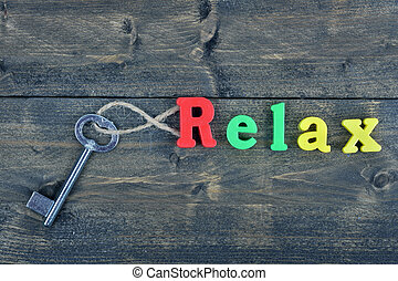 Relax on wooden table - Relax word on wooden table