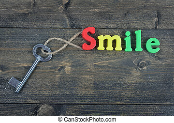Smile on wooden table - Smile word on wooden table