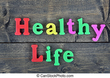 Healty life on wooden table - Healty life word on wooden...