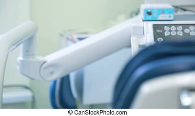 Workplace of dentist with dental unit and chair closeup....