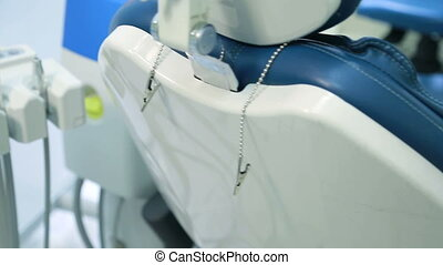 Dental chair and unit assistant or nurse closeup. Armchair...