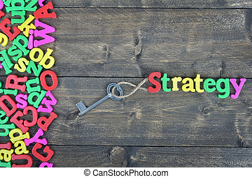 Strategy on wooden table - Strategy word on wooden table