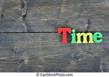 Time on wooden table - Time word on wooden table