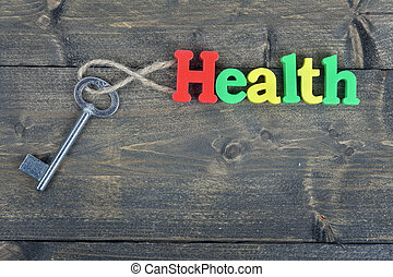 Health on wooden table - Health word on wooden table