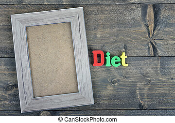 Diet on wooden table - Diet word on wooden table