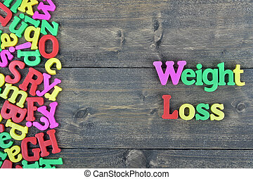 Weight loss on wooden table - Weight loss word on wooden...