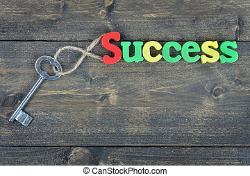 Success on wooden table - Success word on wooden table