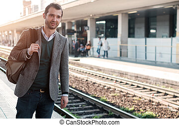 standing man waiting for the train in a train station...