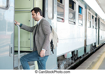 standing man leaving on the train in a train station...