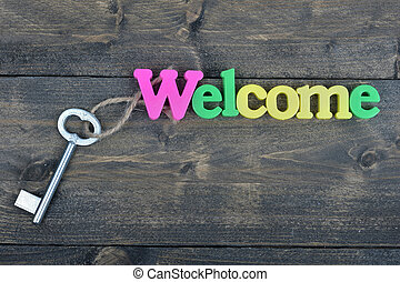 Welcome on wooden table - Welcome word on wooden table
