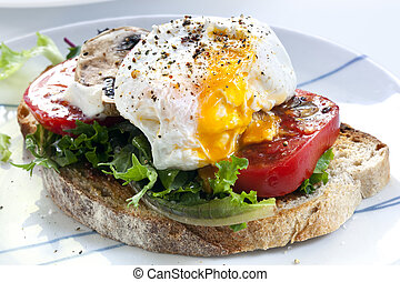Poached Egg on Toast - Poached egg on sourdough toast, with...