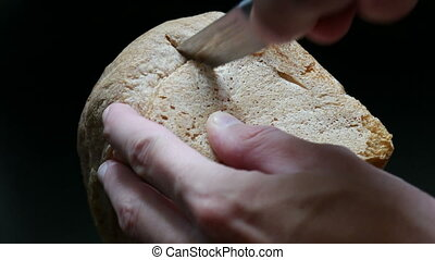 Cutting a slice of bread