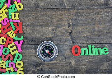 Online on wooden table - Online word on wooden table
