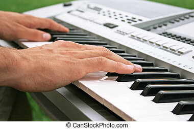 Keyboard player - Musician playing on keyboard.