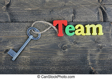 Team on wooden table - Team word on wooden table