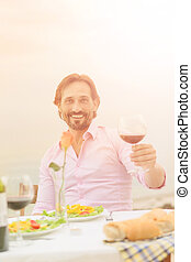 Handsome man drinking wine - Toned picture of handsome...