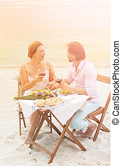 Mature couple outdoor - Toned picture of man and woman...