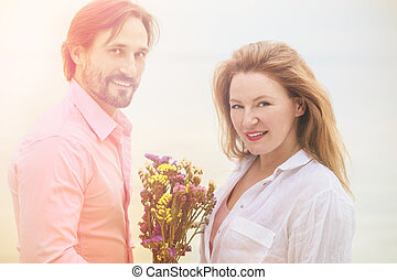 Middle aged couple - Toned picture of happy romantic couple...