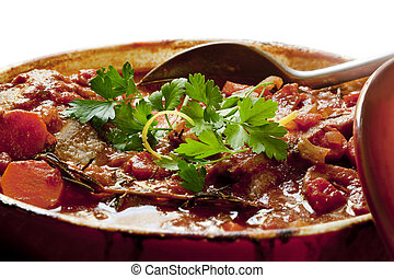 Beef Stew - Beef stew in a red crock pot, ready to serve,...