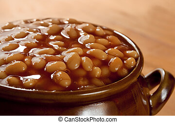 Baked Beans - Baked beans in tomato sauce, in a brown pot.